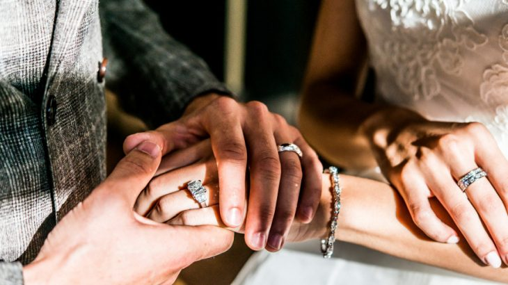 Bride-and-Groom-Holding-Hands-and-Showing-Wedding-Rings-Photo-Idea